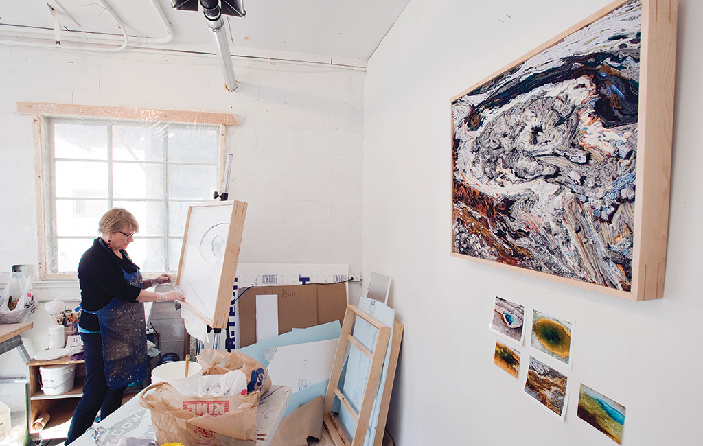 Cheyenne artist Georgia Rowswell works in a studio at the Teton Artlab during her residency there last year. Rowswell uses fabric to capture micro vistas of Yellowstone's thermal features.