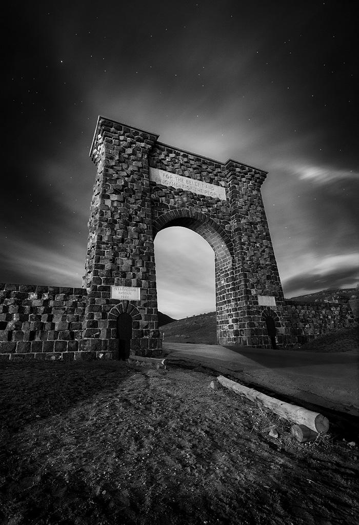 The Roosevelt Arch at Yellowstone's North Entrance stands as a timeless icon welcoming visitors to one of the most popular national parks in the country.