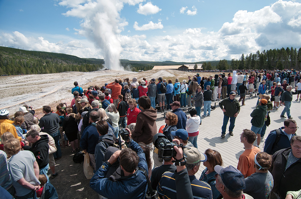 Thousands of tourists gather in the Upper Geyser Basin to watch an eruption of Old Faithful in Yellowstone National Park. In 2015, Yellowstone surpassed four million annual visitors for the first time. The only national parks with more visitors were the Grand Canyon, Great Smoky Mountains, and Yosemite.