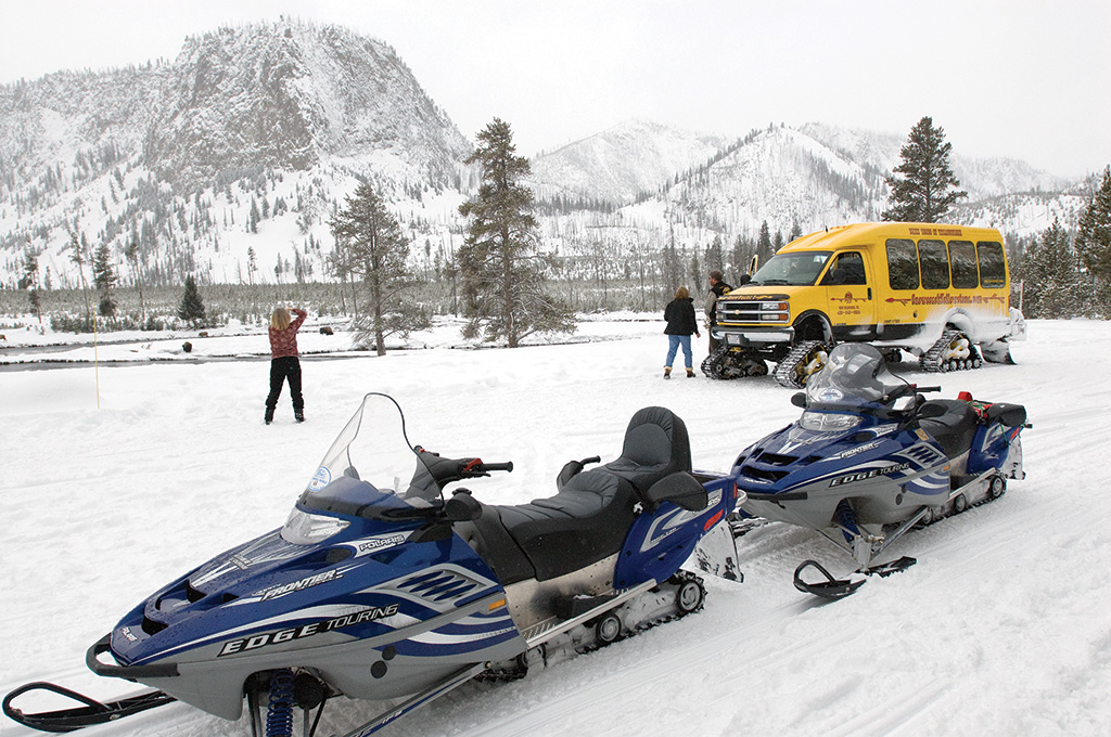Recent agreements have reduced the number of snow machines in Yellowstone in favor of cleaner and quieter snowcoaches in an effort to balance visitor enjoyment with preservation of the natural resources.