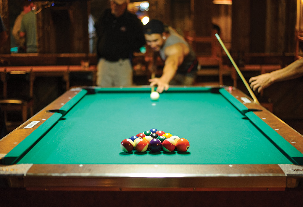 """The Virginian has a """"strong drink for a good price"""" and also pool, darts, karaoke, and cornhole."""