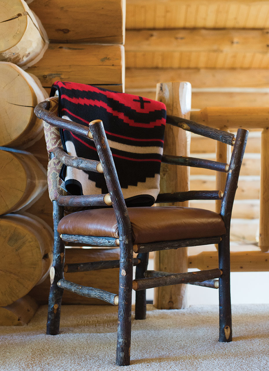 An Armchair Made Of Willow Branches, Accessorized With A Pendleton Wool  Blanket, Is Classic Lodge Style.