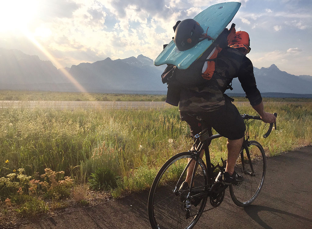 "Tristan Greszko cruises along the pathway in GTNP en route to a swim across Phelps Lake and a climb of Mt. Albright, Static Peak, and Buck Mountain—and back again—in a Picnic dubbed the ""Triple Buck."""