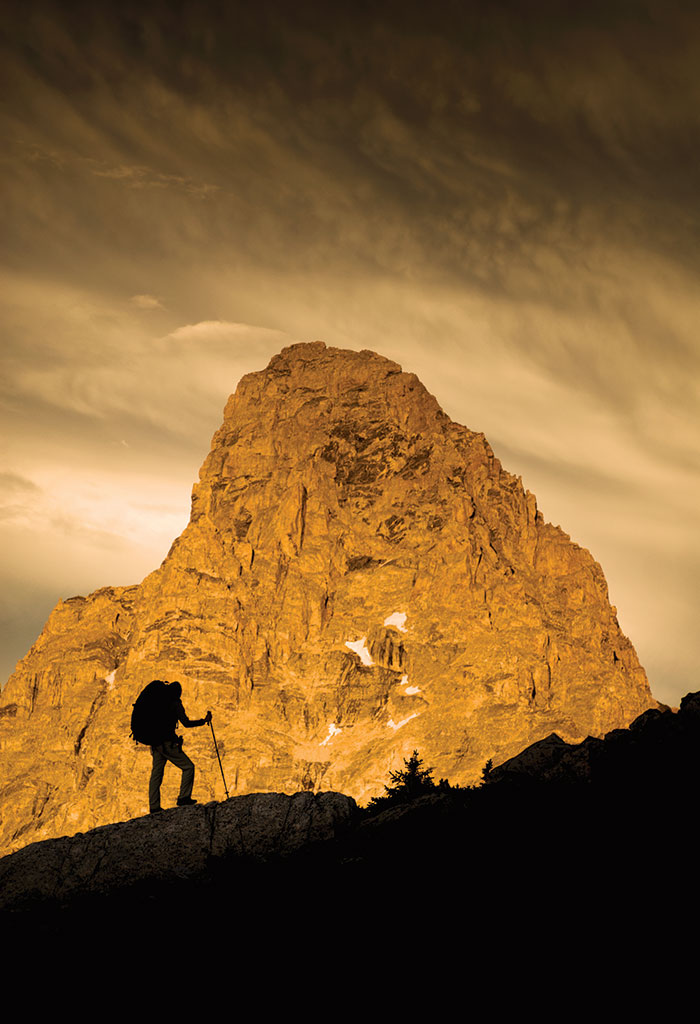 The Grand Teton looms behind a hiker high in the range. Jeff Diener snapped this shot for MontBell Japan.