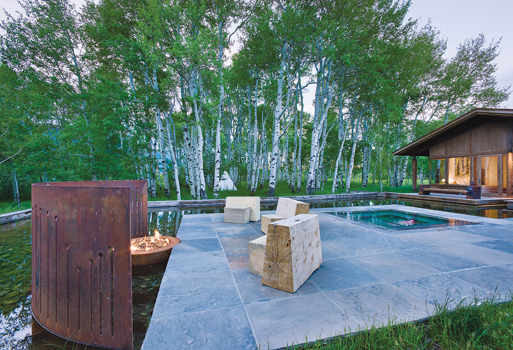 Ward combined a fire pit with water at this home near Teton Village.