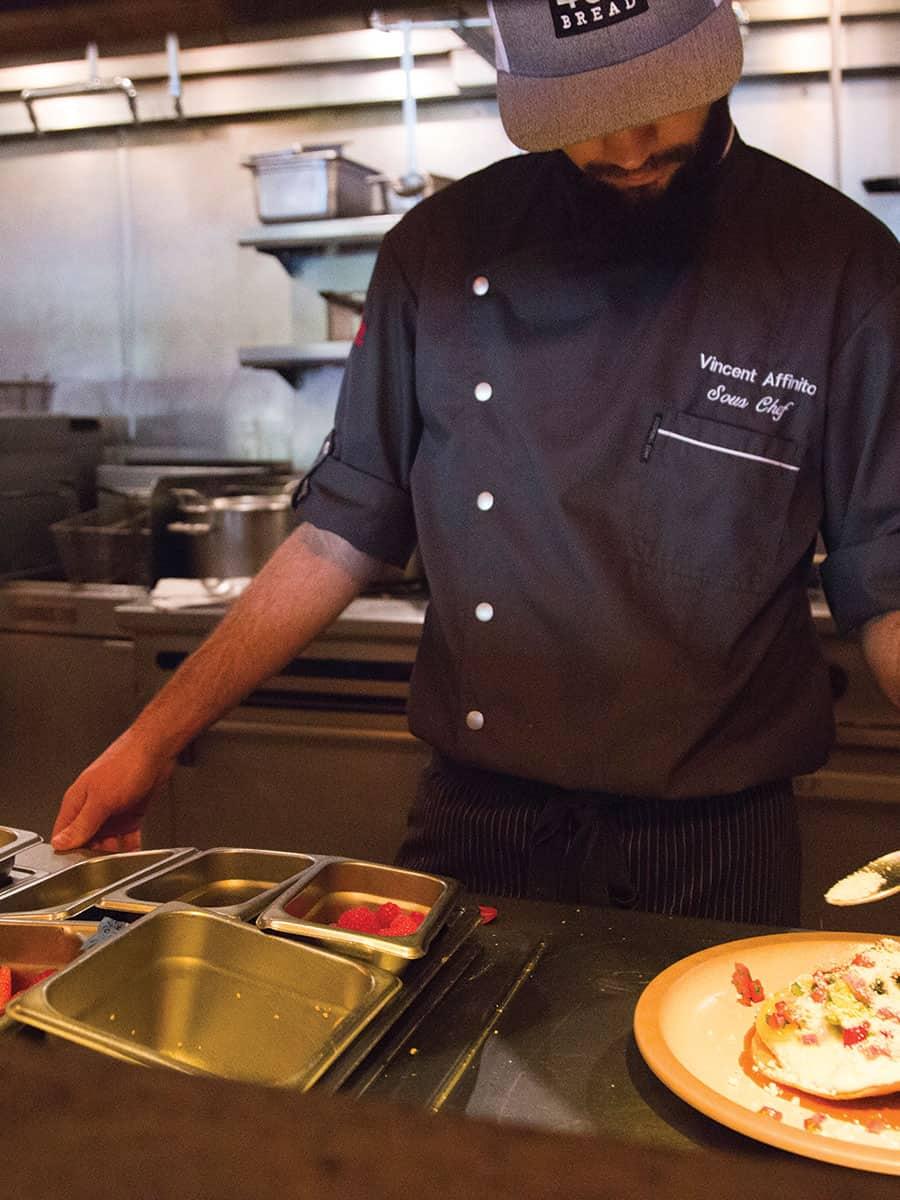Affinito prepares the huevos rancheros, his favorite dish, at Westbank Grill.