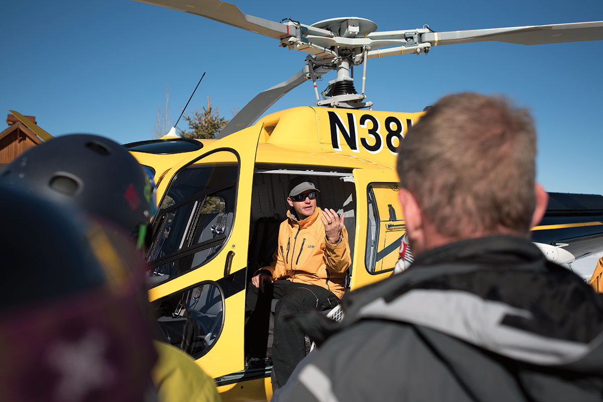High Mountain Heli-Skiing pilot Steve Wilson instructs clients on the protocols for boarding, takeoff, and landing.
